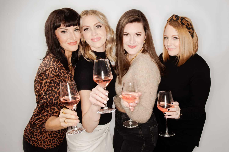 epagaFOTO 4 women photographers holding wine